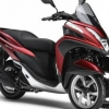 Скутер триколісний: два колеса попереду або два колеса ззаду